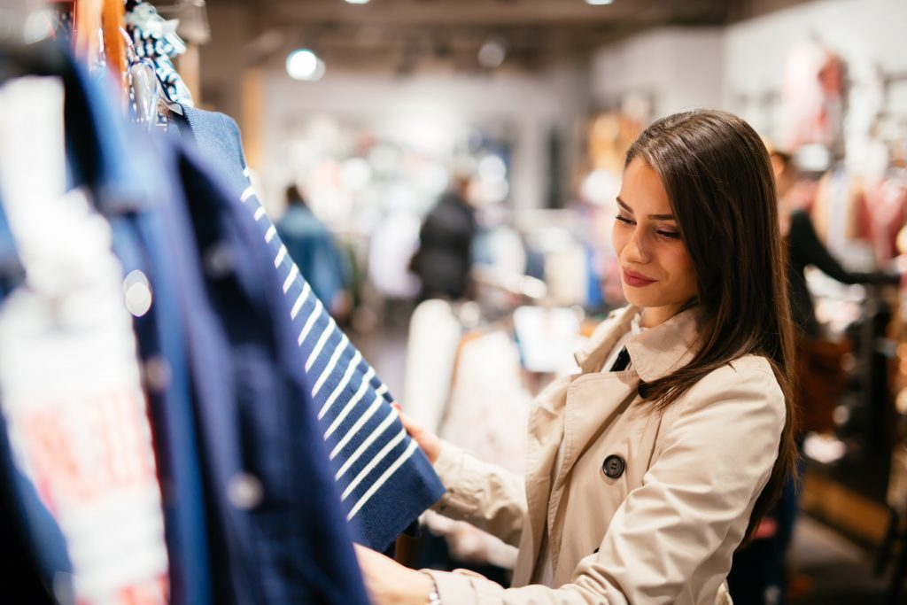 brunette woman browsing clothes, mall in dallas shopping