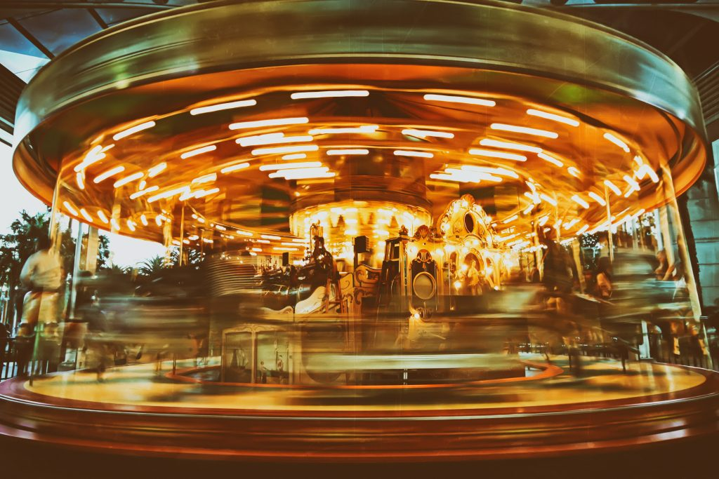 long exposure of a carousel spinning at night amusement park ghosts dallas tx