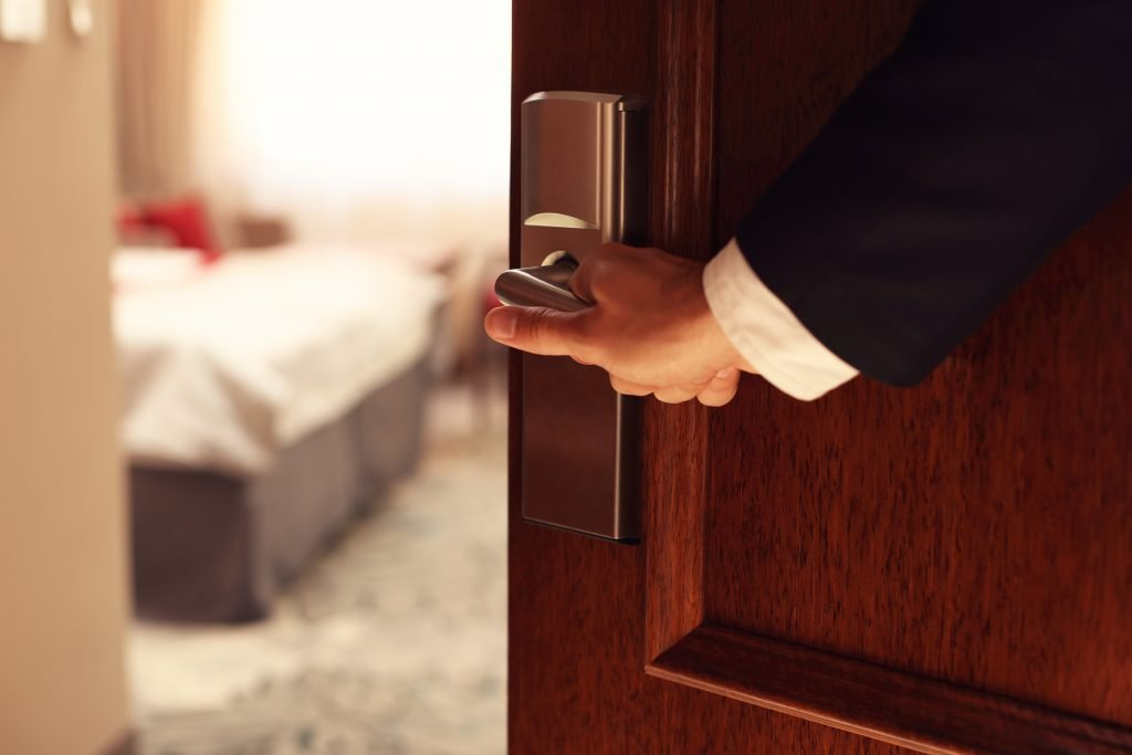 person opening up a hotel room door, haunted places in dallas tx