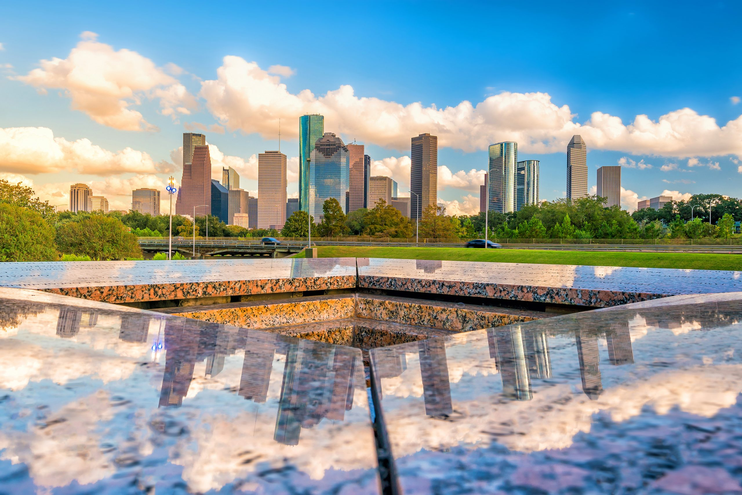 downtown houston skyline as seen from across a reflecting pool, best quotes about houston sayings