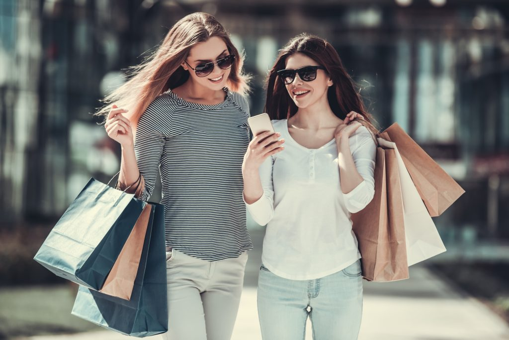 two women with bags shopping dallas texas