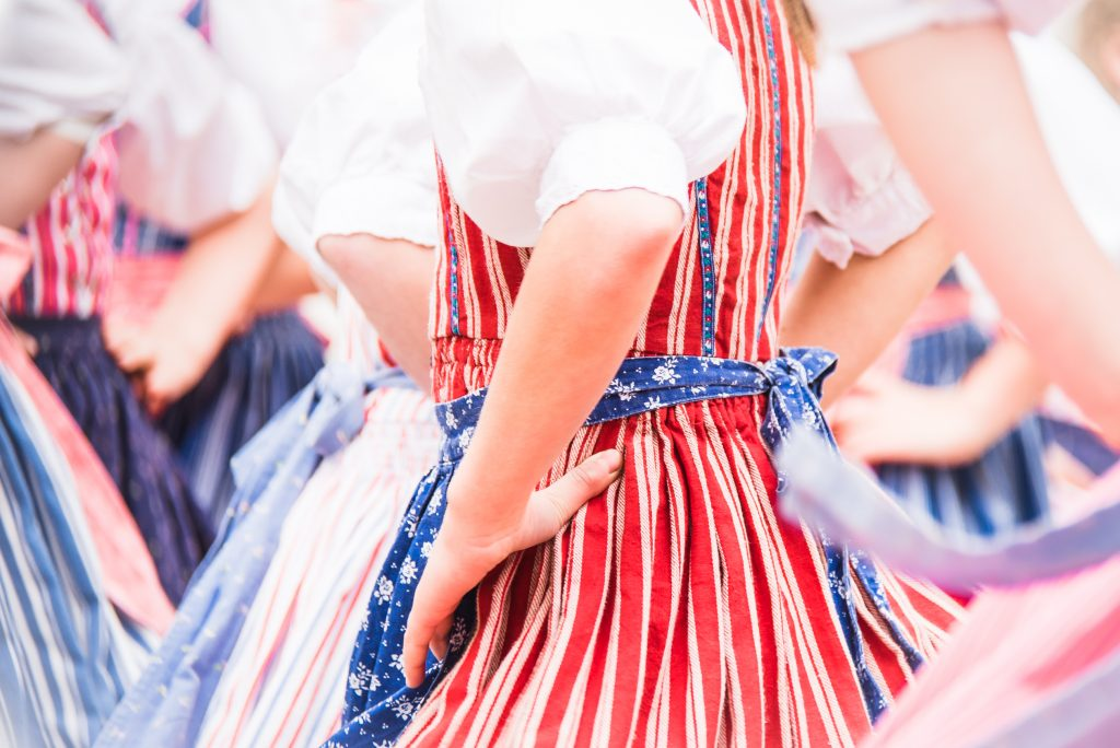 close up of czech texas festival dancers dressed in red white and blue