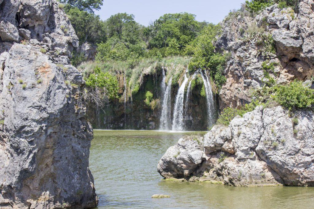 falls creek waterfall lake buchanan, a fun stop on a texas hill country road trip itinerary